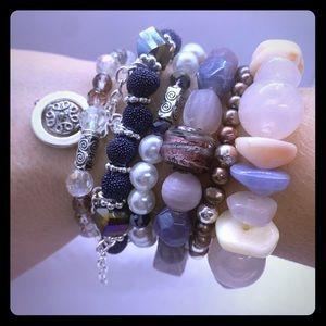 Purple and pink stacking bracelets.